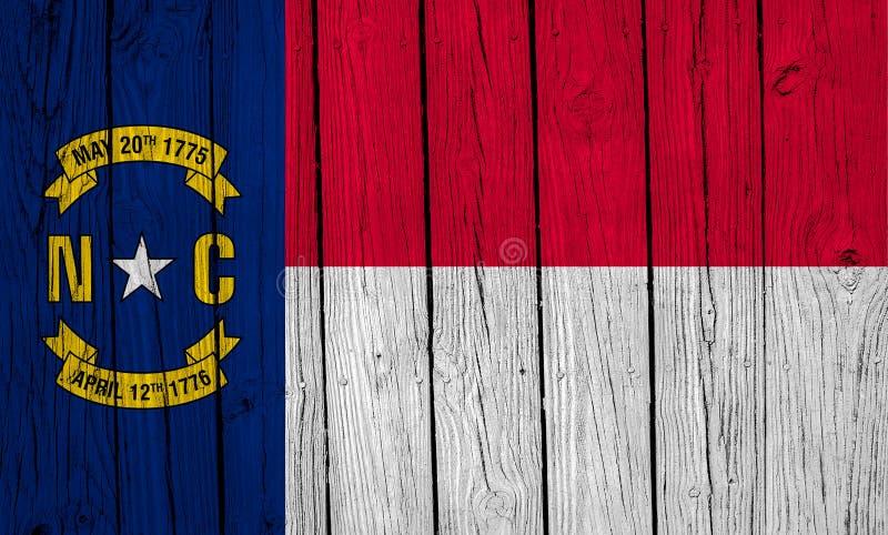 Flaga stanowa Północna Karolina nad planetami leśnymi fotografia royalty free
