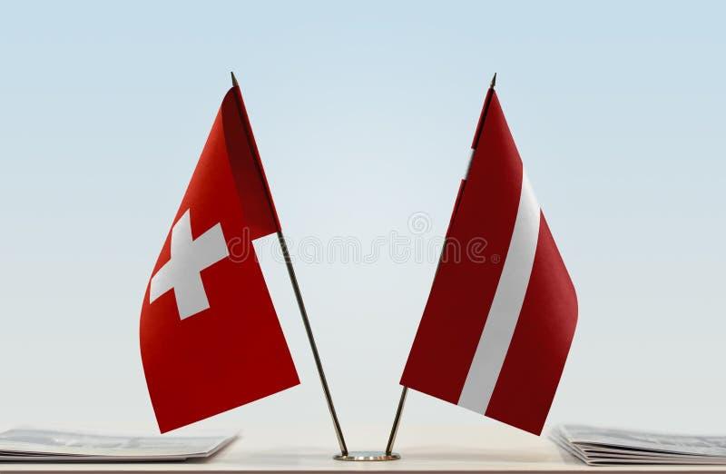 Flaga Szwajcaria i Latvia obrazy royalty free