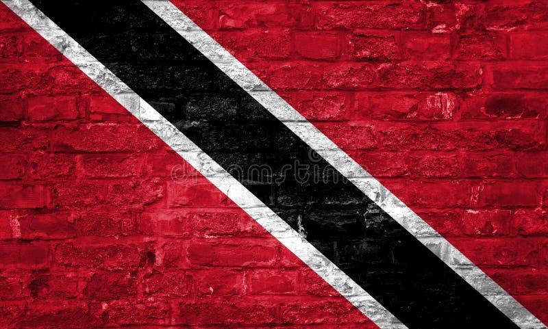 Flaga Trinidad i Tobago nad starym ściany z cegieł tłem, powierzchnia obrazy royalty free