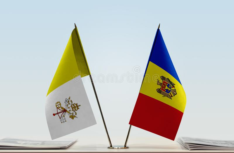 Flaga watykan i Moldova zdjęcie royalty free