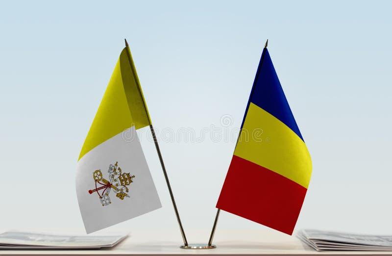 Flaga watykan i Rumunia zdjęcie stock