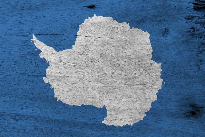 Flagga av Antarktis på träplattabakgrund Textur för GrungeAntarktis flagga royaltyfri bild
