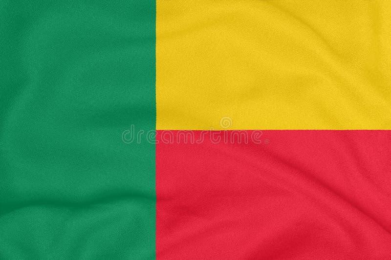 Flagga av Benin på texturerat tyg patriotiskt symbol royaltyfria bilder