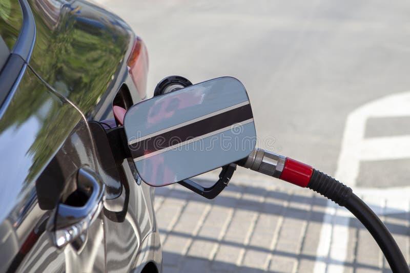 Flagga av Botswana på klaffen för utfyllnadsgods för bränsle för bil` s royaltyfri fotografi