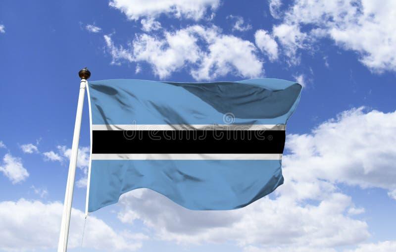 Flagga av Botswana som fladdrar under en blå himmel arkivbild
