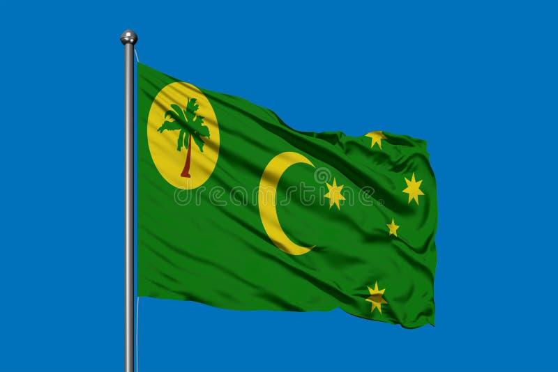 Flagga av Cocosöar som vinkar i vinden mot djupblå himmel Keeling öar sjunker royaltyfria foton