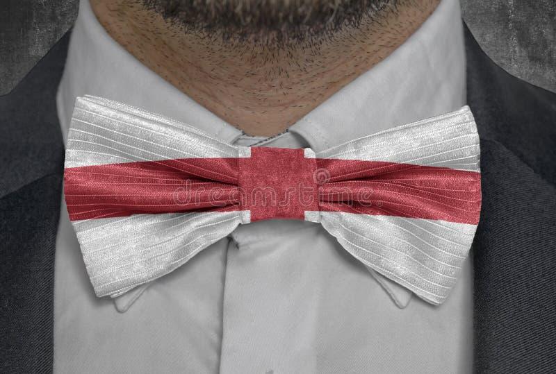 Flagga av det nationella landet England på dräkt för bowtieaffärsman arkivfoton