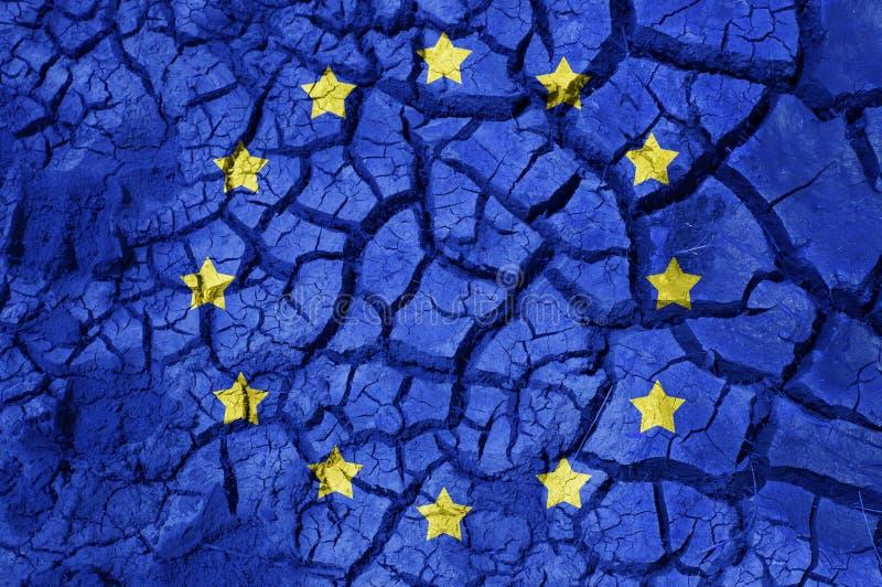 Flagga av Europa på sprucken jordbakgrund royaltyfri foto
