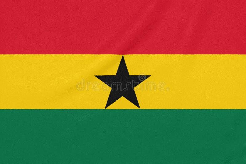 Flagga av Ghana på texturerat tyg patriotiskt symbol royaltyfri foto