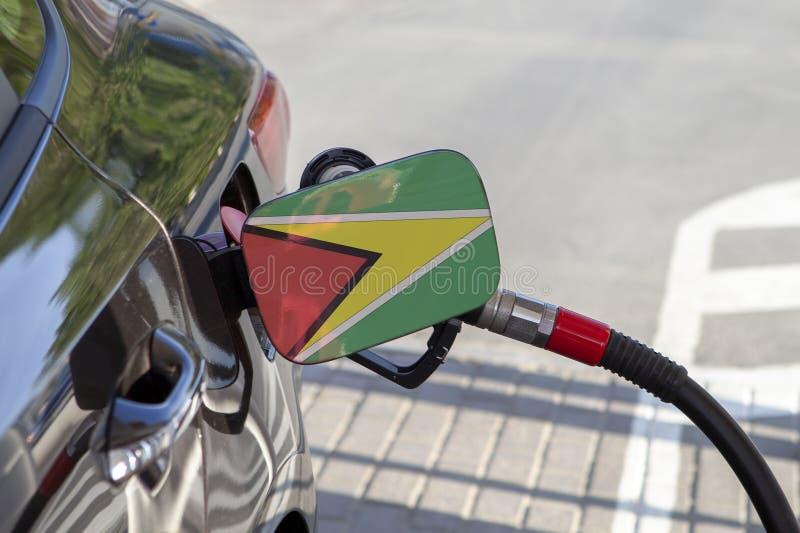 Flagga av Guyana på klaffen för utfyllnadsgods för bränsle för bil` s arkivbilder