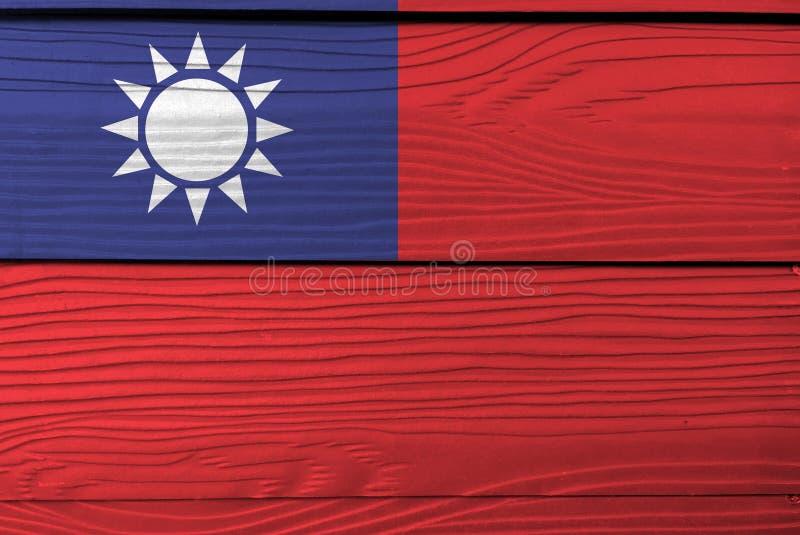 Flagga av kinesiska Taipei på träplattabakgrund Textur för GrungeTaiwan flagga royaltyfri bild