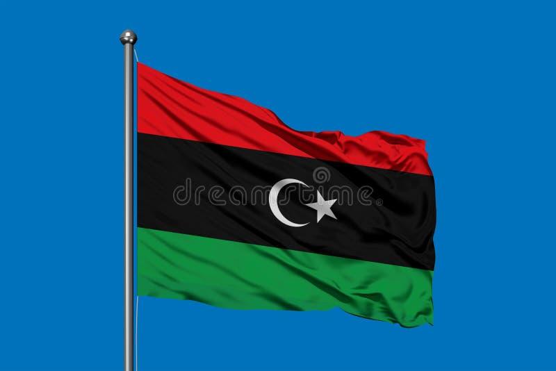 Flagga av Libyen som vinkar i vinden mot djupblå himmel Libysk flagga royaltyfri bild