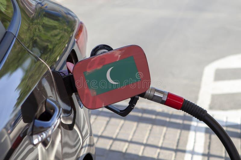 Flagga av Maldiverna på klaffen för utfyllnadsgods för bränsle för bil` s royaltyfri foto