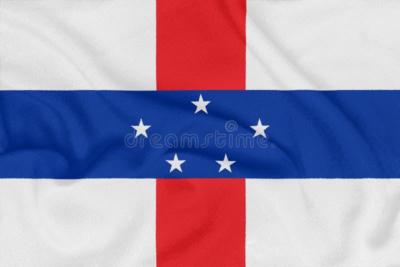 Flagga av Nederländerna Antillerna på texturerat tyg patriotiskt symbol arkivbild
