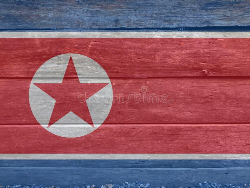 Flagga av Nordkorea på träväggbakgrund Nordkoreansk flaggatextur för Grunge royaltyfria bilder