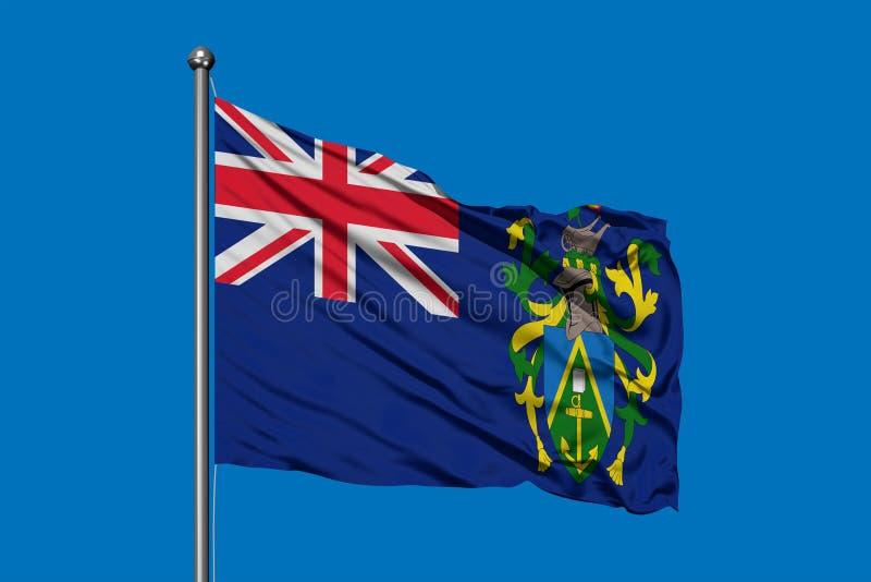 Flagga av Pitcairn öar som vinkar i vinden mot djupblå himmel arkivbilder