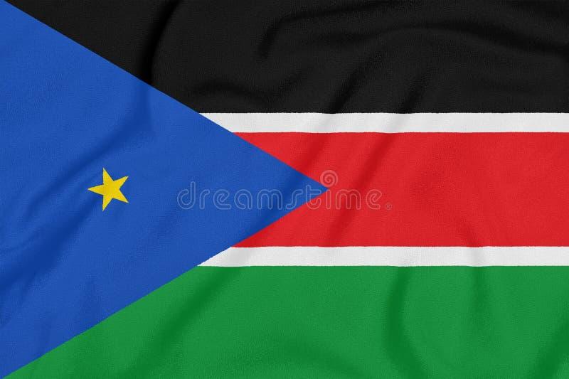 Flagga av södra Sudan på texturerat tyg patriotiskt symbol royaltyfria bilder