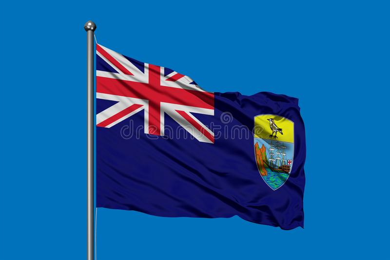 Flagga av St Helena som vinkar i vinden mot djupblå himmel Uppstigningflagga royaltyfri fotografi