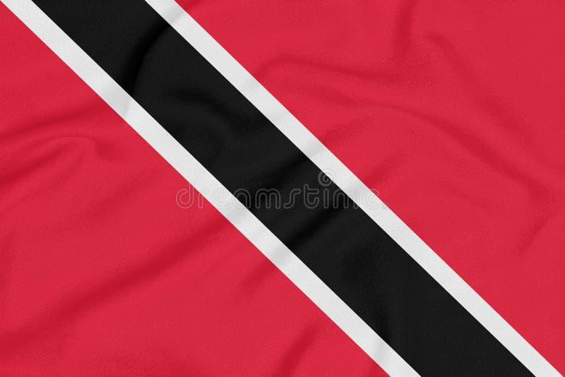 Flagga av Trinidad och Tobago på texturerat tyg patriotiskt symbol arkivfoto