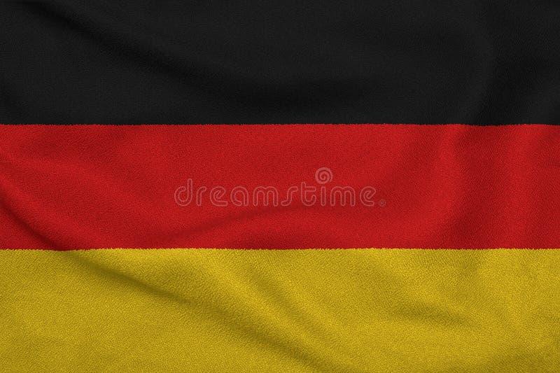 Flagga av Tyskland från det fabrik stack tyget Bakgrunder och texturer arkivbilder