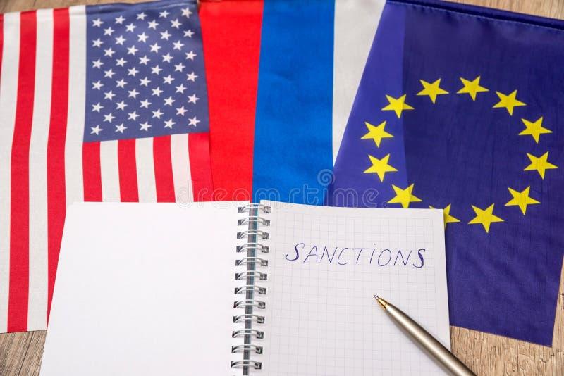 Flagga av USA och Europa Sanktioner av Ryssland fotografering för bildbyråer