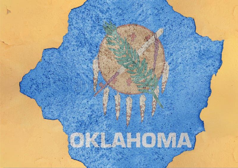 Flagga av USA-staten Oklahoma i stort brutet materialbetonghål royaltyfria bilder