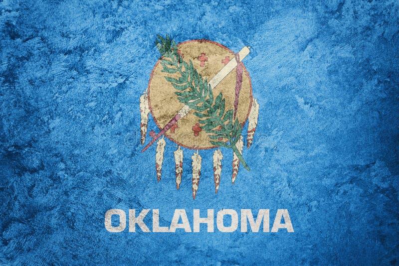 Flagga för GrungeOklahoma tillstånd Text för grunge för Oklahoma flaggabakgrund stock illustrationer