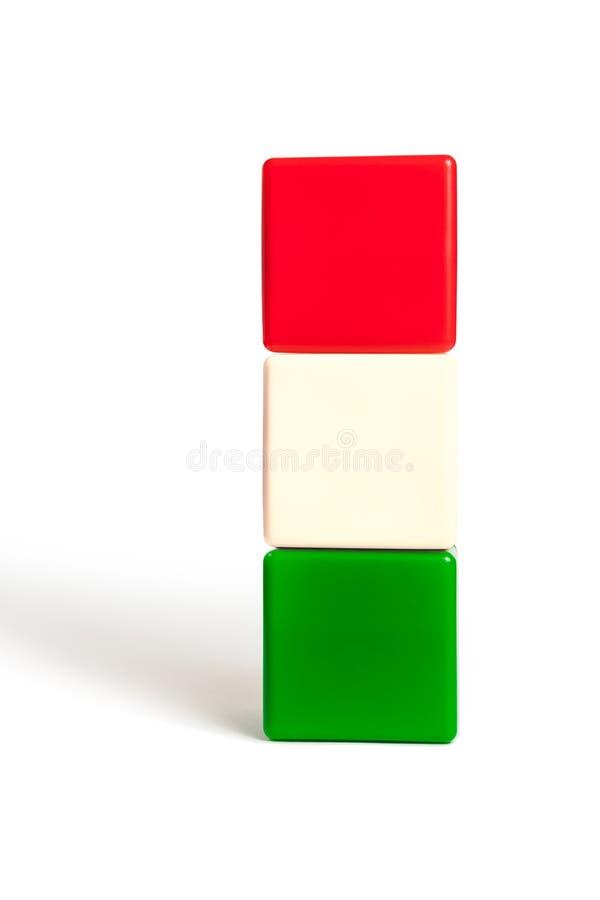 Flaggaf?rger av Ungern i form av barns kuber P? vitt som isoleras med skugga fotografering för bildbyråer
