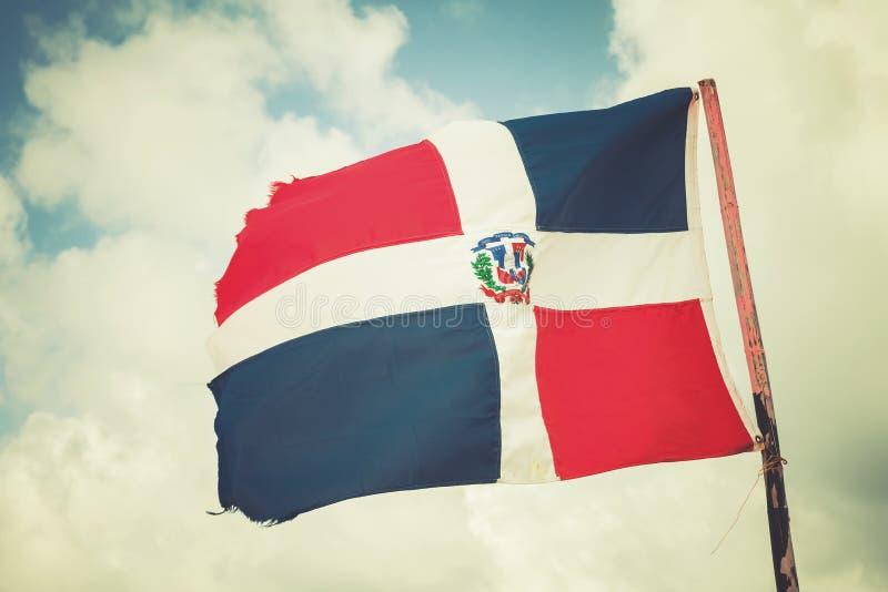 Flaggan av Dominikanska republiken vinkar på vind fotografering för bildbyråer