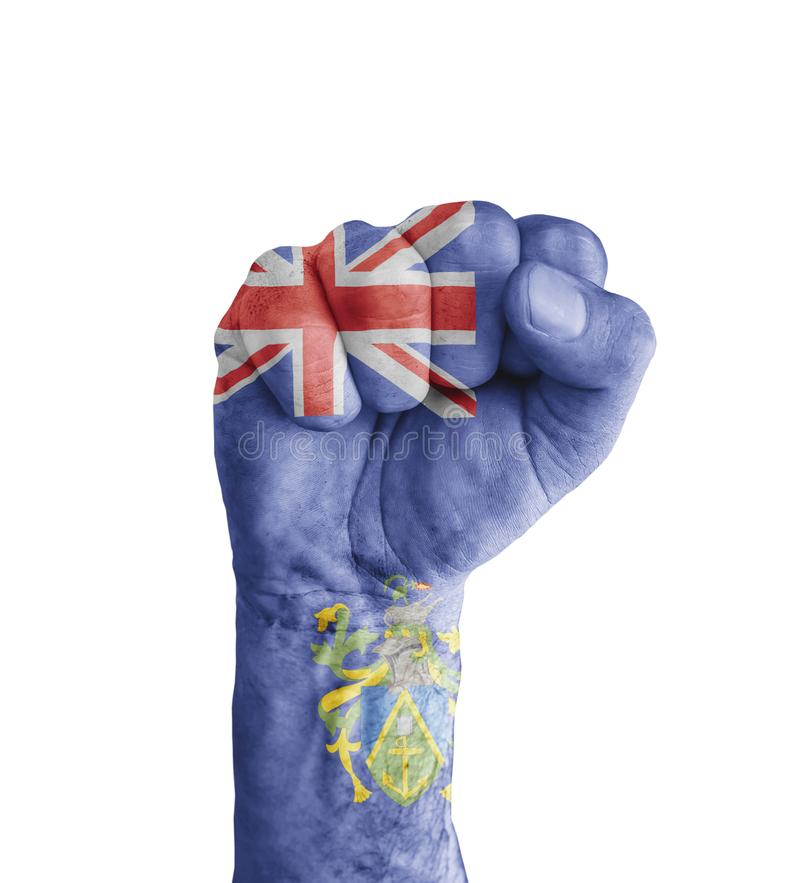 Flaggan av Pitcairn öar målade på den mänskliga näven som seger arkivbild