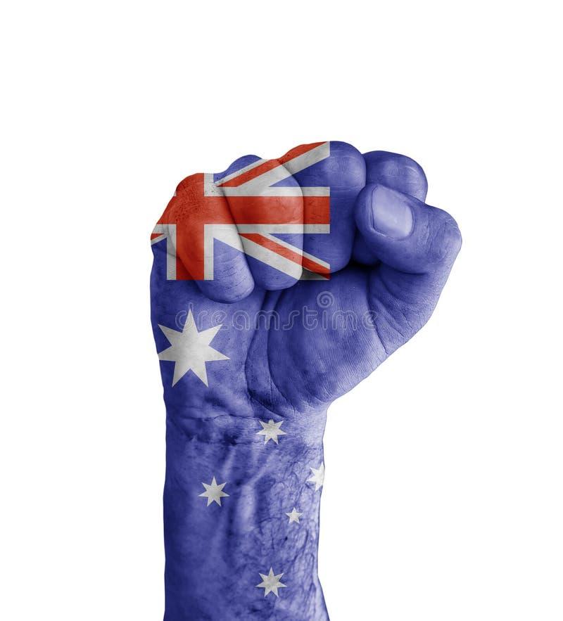 Flaggan av USA Australien målade på den mänskliga näven som segersymbol arkivfoto