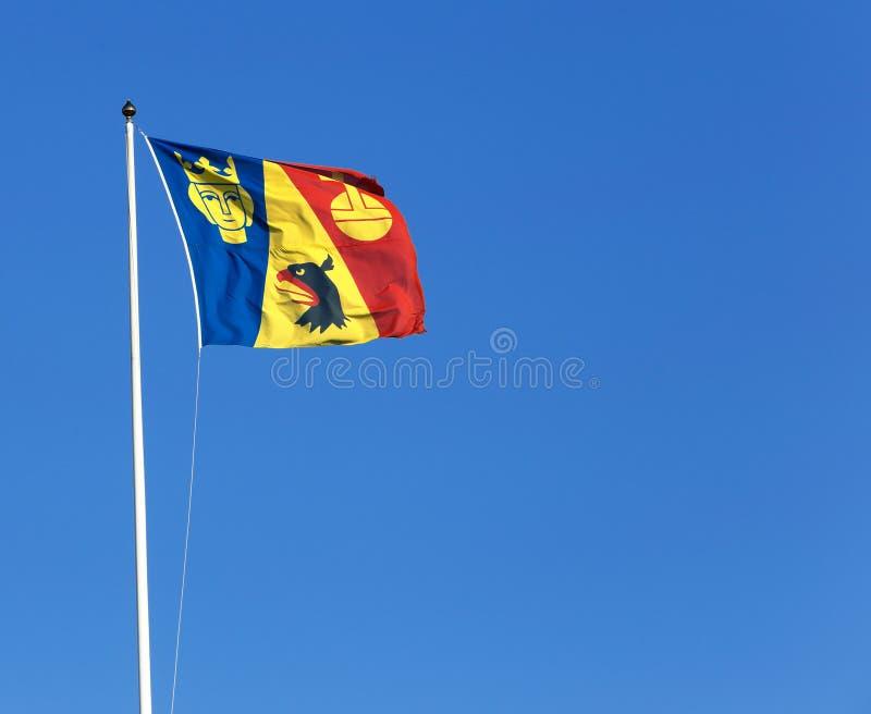 Flaggan Stockholm County för administrativt bräde royaltyfria foton