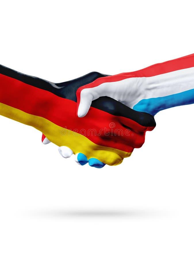 FlaggaTyskland, Luxembourg länder, begrepp för partnerskapkamratskaphandskakning arkivbilder