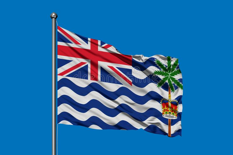 Flagge des Britischen Territoriums im Indischen Ozean wellenartig bewegend in den Wind gegen tiefen blauen Himmel lizenzfreie abbildung