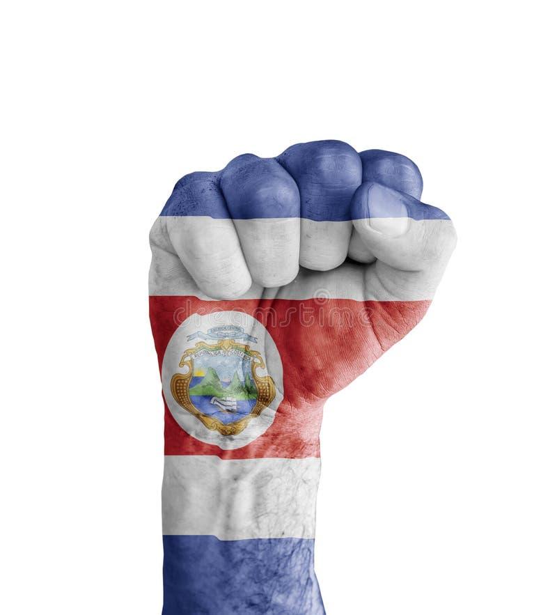 Flagge von Costa Rica malte auf menschlicher Faust wie Siegsymbol stockbilder