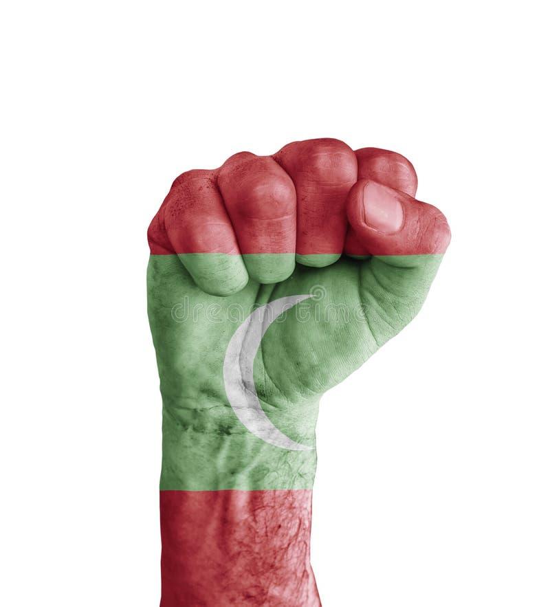 Flagge von Malediven malte auf menschlicher Faust wie Siegsymbol stockbilder