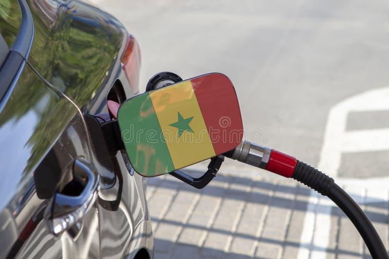 Flagge von Senegal auf der Auto ` s Brennstoff-Füllerklappe lizenzfreie stockbilder