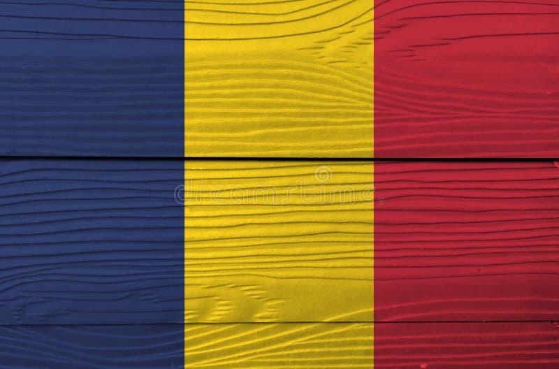 Flagge von Tschad auf hölzernem Wandhintergrund Schmutz-Tschad-Flaggenbeschaffenheit lizenzfreie stockbilder