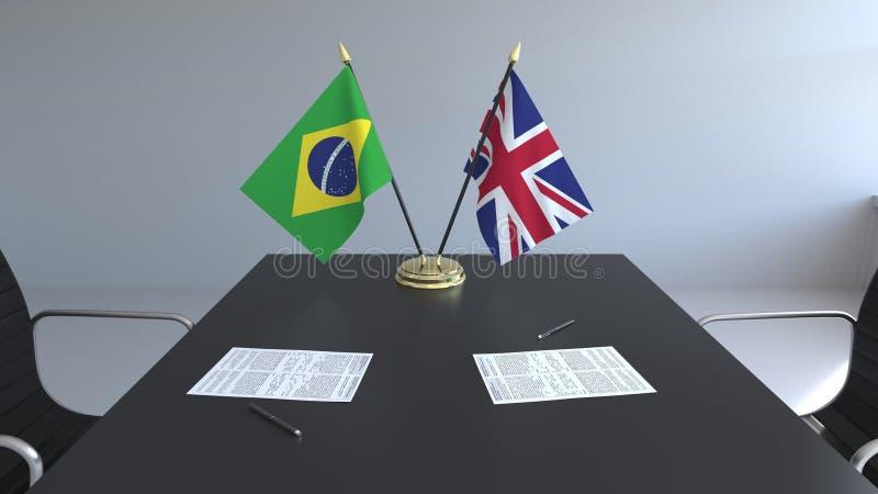 Flaggen von Brasilien und Großbritannien und Papiere auf dem Tisch Verhandlungen und Unterzeichnen eines internationalen Abkommen stock abbildung