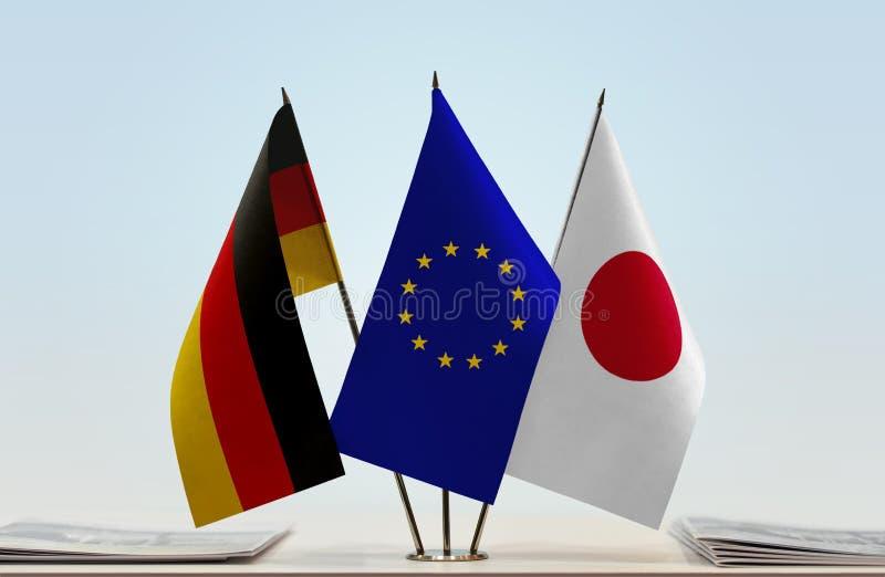 Flaggen von Deutschland EU und von Japan stockfotos