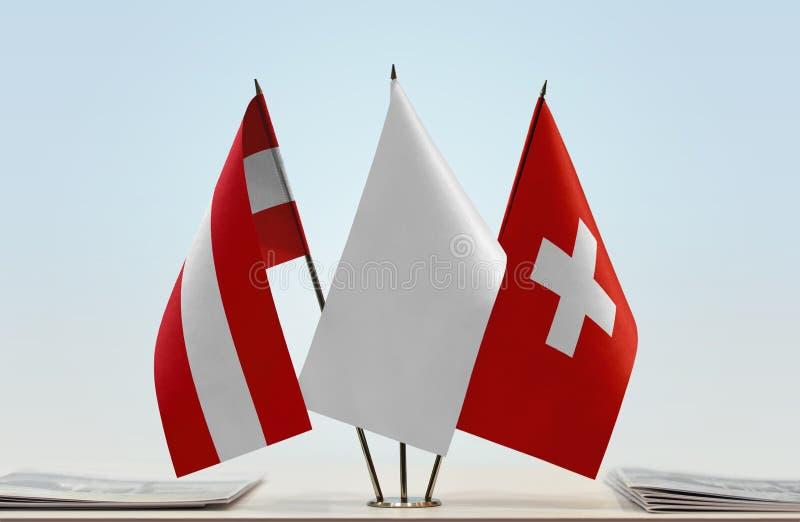 Flaggor av Österrike och Schweiz arkivbilder