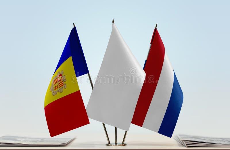 Flaggor av Andorra och Nederländerna arkivfoto