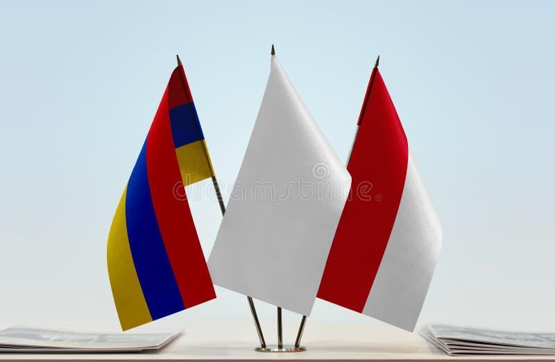 Flaggor av Armenien och Monaco royaltyfri bild