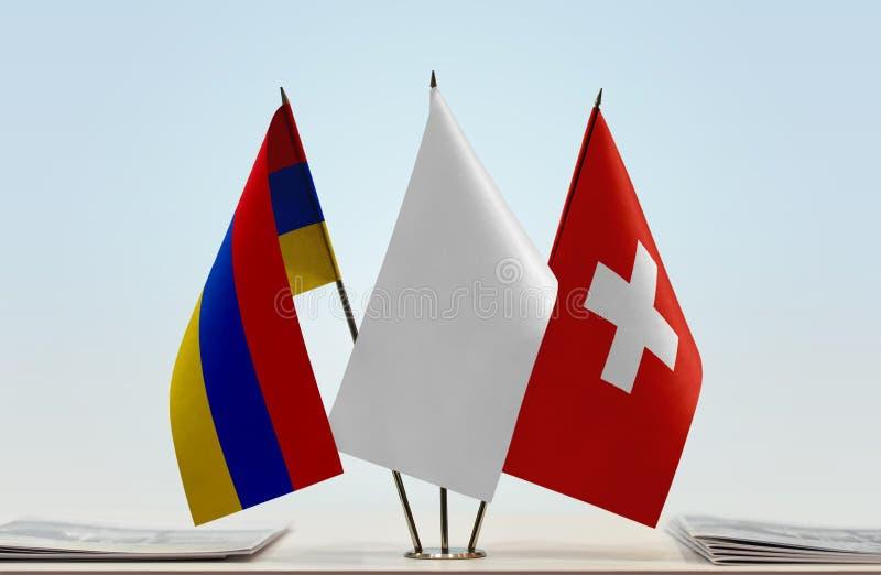 Flaggor av Armenien och Schweiz royaltyfri bild