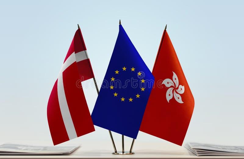 Flaggor av Danmark EU och Hong Kong royaltyfri foto