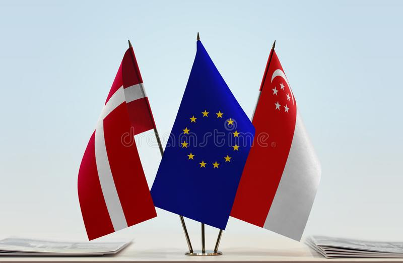 Flaggor av Danmark EU och Singapore royaltyfria bilder