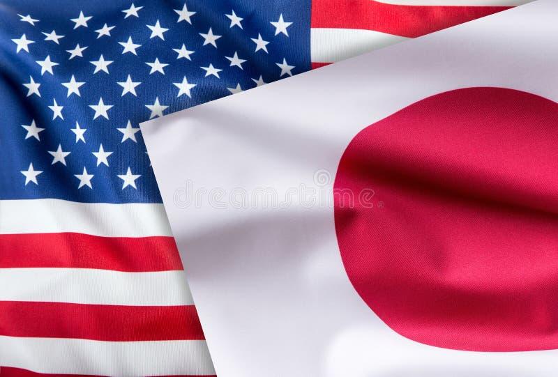 Flaggor av den USA och Japan flaggan tillsammans royaltyfria foton
