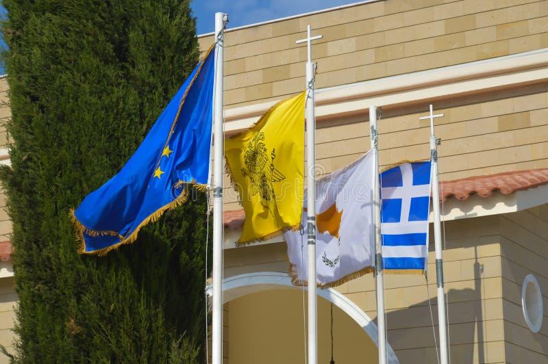 Flaggor av europeisk union, Cypern och Grekland på solig dag royaltyfria bilder