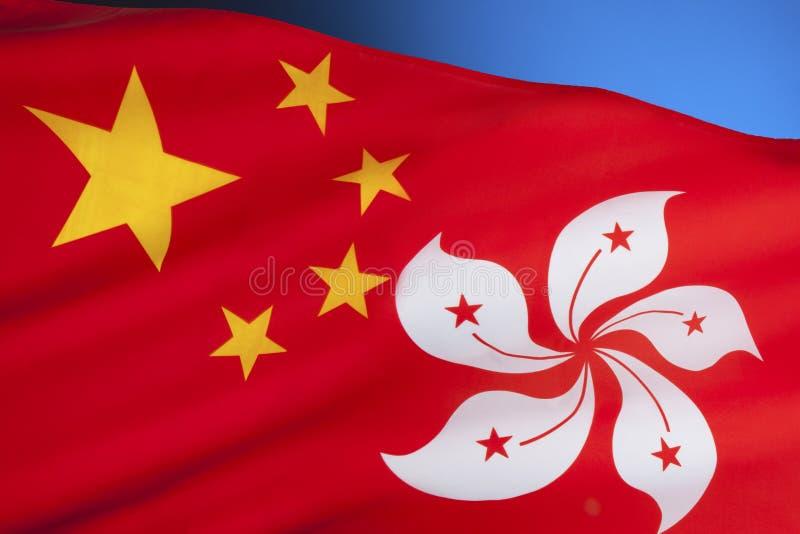 Flaggor av folket Republiken Kina och Hong Kong royaltyfria bilder