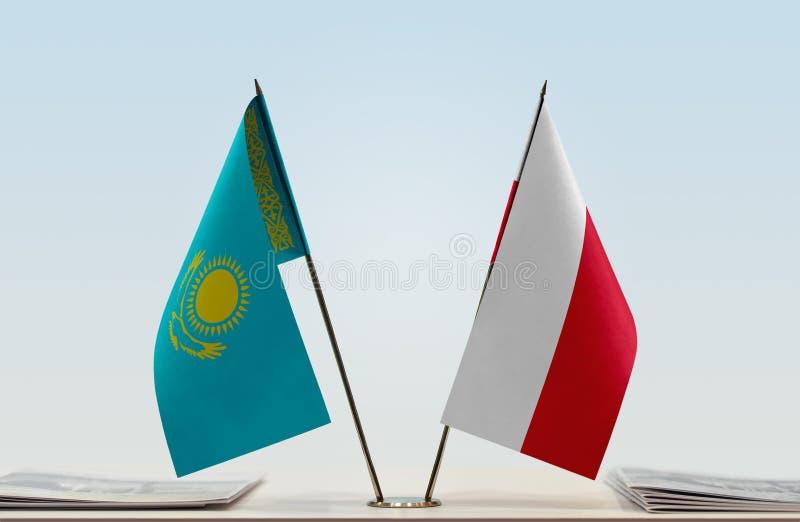 Flaggor av Kasakhstan och Polen fotografering för bildbyråer